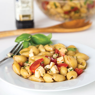 Caprese Pasta Salad Recipe – turn classic Caprese salad into a quick pasta salad. Great for summer get togethers, quick lunches, or a light dinner #STARFineFoods