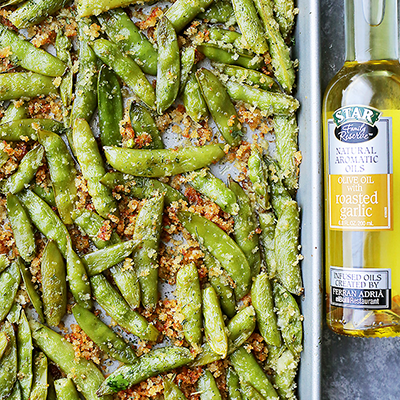 Healthy, delicious and quick to make roasted sugar snap peas tossed in STAR Olive Oil Infused with Roasted Garlic and a crunchy and flavorful Parmesan cheese mixture. #STARFineFoods