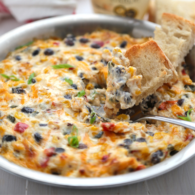 This roasted southwest vegetable cheese dip recipe is super quick and simple to make for a crowd, using frozen vegetables and lots of gooey cheese! #STARFineFoods