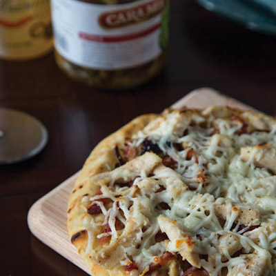 This quick and easy white pizza recipe contains naan bread topped with grilled artichokes, bacon, chicken, and cheese.  #STARFineFoods