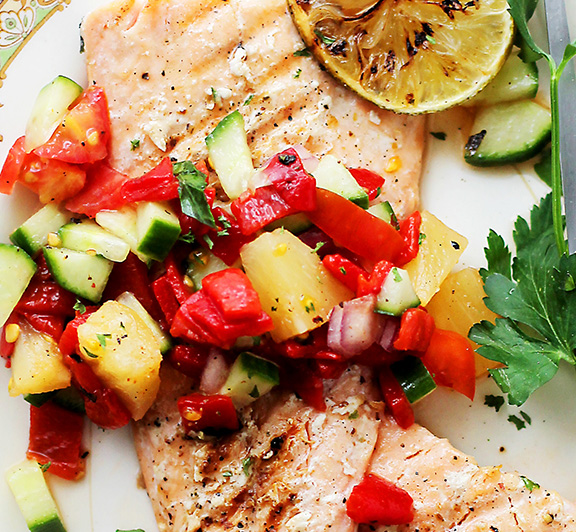 This recipe features an easy, fresh and wonderfully flavorful Pineapple & Piquillo Peppers Salsa recipe served atop tender grilled Salmon.  #STARFineFoods