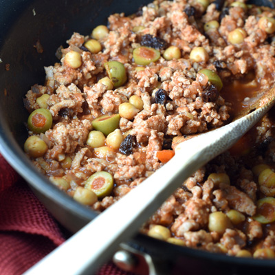 This Ground Turkey Picadillo is simmered in tomato sauce, STAR Reduced Sodium Pimiento Stuffed Manzanilla Olives, beans, raisins, and spices. It's the perfect mixture served over rice, on rolls, or as taco filling!  #STARFineFoods