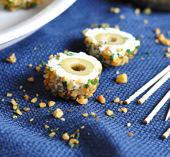 Marinated olives are coated in an herbed-cheese mixture, then rolled in toasted nuts for an easy and super tasty appetizer! #STARFineFoods