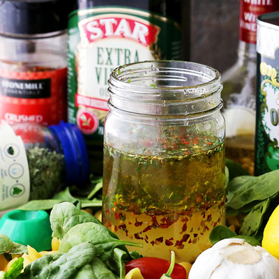 This incredibly delicious, zesty Italian dressing recipe is so easy to make and so flavorful, you will never want to buy salad dressing again. #STARFineFoods