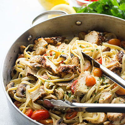 This one-pan Lemon Chicken Fettuccine recipe is a fresh and easy take on dinner, tossed with tomatoes, mushrooms, lemon juice and STAR Extra Virgin Olive Oil. #STARFineFoods
