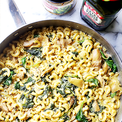 Stove top one-pot Mac 'n Cheese recipe packed with spinach and artichokes, and a creamy cheese sauce. Dinner will be ready in under 30 minutes! #STARFineFoods