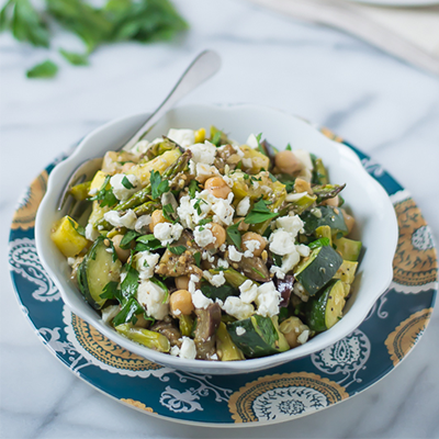 This Mediterranean Salad recipe is a mini Greek vacation in a bowl with fresh ingredients like asparagus, eggplant, zucchini, yellow squash, and creamy feta cheese.  #STARFineFoods