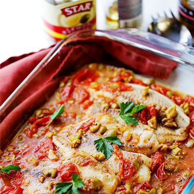 A quick, easy, and healthy fish recipe with olives and tomatoes that's perfect for a weeknight dinner, and fancy enough for a dinner party! #STARFineFoods