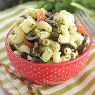 A macaroni salad with a Mexican twist! Packed with black beans, fresh tomatoes, jack cheese, fresh corn, and STAR Pitted Ripe Olives Without Liquid, this is the perfect side dish to bring to your next summer BBQ. #STARFineFoods