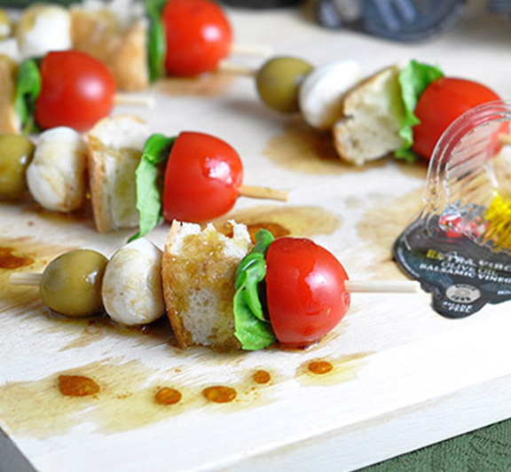 Mini Caprese Skewers – your favorite caprese salad recipe served on a skewer as an appetizer. Comes together in only 10 minutes! #STARFineFoods