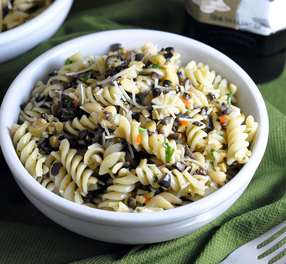 Olive and Pine Nut Pasta Recipe – this is an ideal summer dish where olives and pine nuts are the stars. Simple, delicious, and the only cooking required is the pasta! #STARFineFoods
