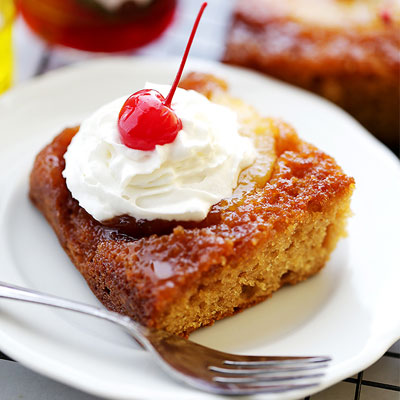 An easy recipe for super moist, homemade pineapple upside-down cake made with STAR Extra Light Olive Oil, yogurt, and a buttery-sweet brown sugar topping. #STARFineFoods