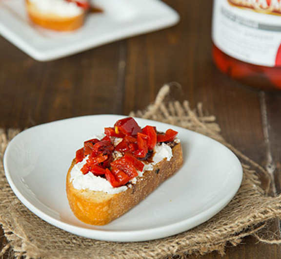 Piquillo Pepper and Goat Cheese Crostini – crispy crostini topped with goat cheese, chopped piquillo peppers and drizzled with balsamic vinegar.  The perfect easy appetizer for any get together.