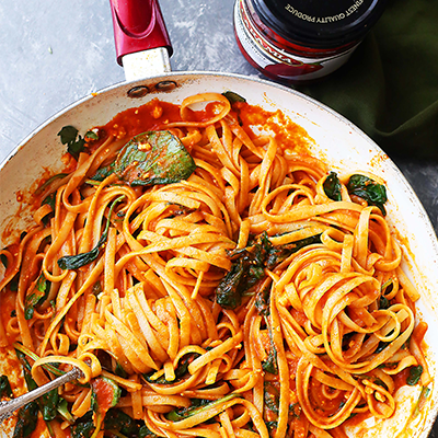 A perfect weeknight meal recipe featuring sweet red peppers blended into a delicious and healthy sauce tossed with fettuccine pasta, spinach and feta cheese. #STARFineFoods