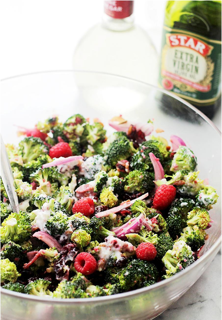 Simple, healthy, and easy-to-make! This Broccoli Salad recipe has nuts, fruits, bacon and a delicious homemade Raspberry Vinaigrette! #STARFineFoods