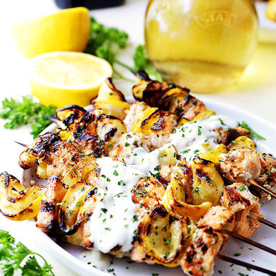 Tender and moist, these grilled salmon kabobs are juicy with incredible flavor and are served with an amazing garlic yogurt sauce. #STARFineFoods