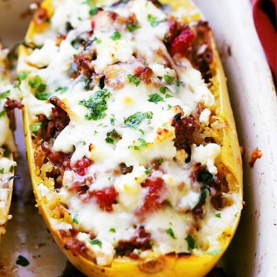 Low carb, healthy, easy-to-make Spaghetti Squash boats loaded with ground turkey, tomatoes, kale and feta cheese. #STARFineFoods