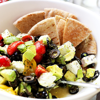 A delicious, colorful and summery avocado salad with STAR Spanish Ripe Pitted Olives, tomatoes and feta cheese. #STARFineFoods