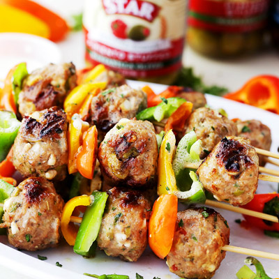 Juicy, grilled turkey meatballs stuffed with STAR Reduced Sodium Pimiento Stuffed Manzanilla Olives and feta cheese! Makes a delicious dinner, but are also great served as an appetizer, too! #STARFineFoods