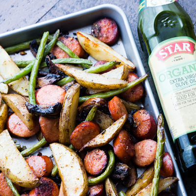 This recipe features deliciously seasoned andouille sausage, potatoes, and veggies, all prepared in one pan and ready in just 30 minutes! #STARFineFoods