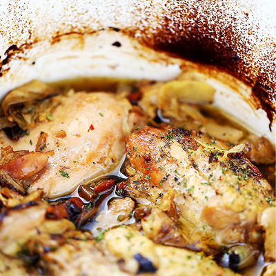 Melt-in-your-mouth chicken thighs prepared in the crock pot with artichoke hearts and sun-dried tomatoes. #STARFineFoods
