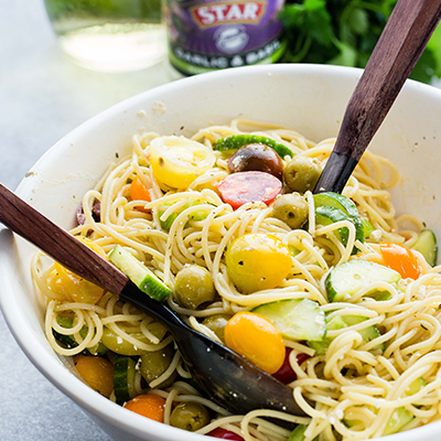 Packed with fresh summer veggies, STAR Olives, and feta cheese, this delicious recipe for Spaghetti Salad is perfect for all your summer picnics, potlucks, and parties! #STARFineFoods