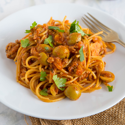 This Spanish Spaghetti with Olives recipe offers a fun twist on your classic spaghetti with meat sauce! This is a quick and easy dinner the whole family will love. #STARFineFoods