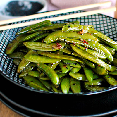 Perfect as a simple snack or side dish, this Spicy Roasted Sugar Snap Peas recipe is healthy and simply delicious! #STARFineFoods
