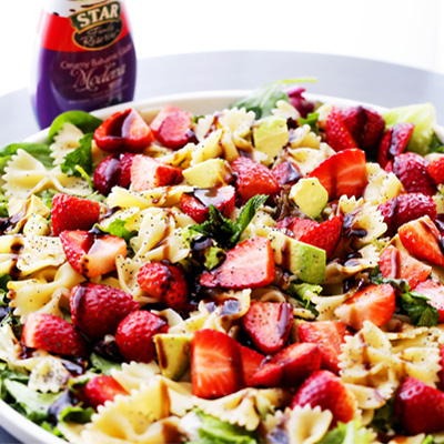 Strawberries, avocados and bow tie pasta all tossed with our irresistibly creamy Modena Balsamic Glaze! #STARFineFoods
