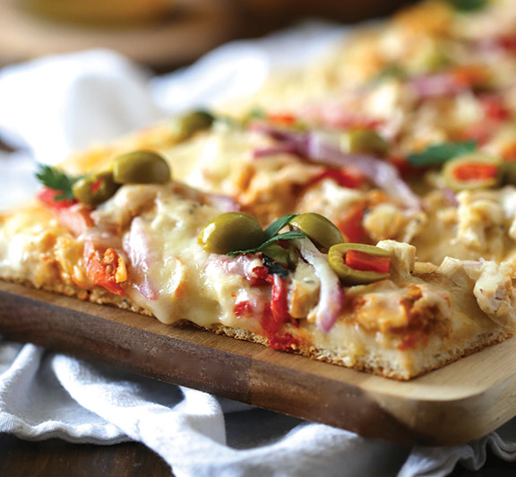 This Chicken Pizza with Olives & Roasted Red Peppers will transport you directly to the shores of Tunisia with it's delicious, Mediterranean flavors. #STARFineFoods